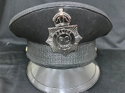 Black Hard Police Hat with Plastic attached Badge
